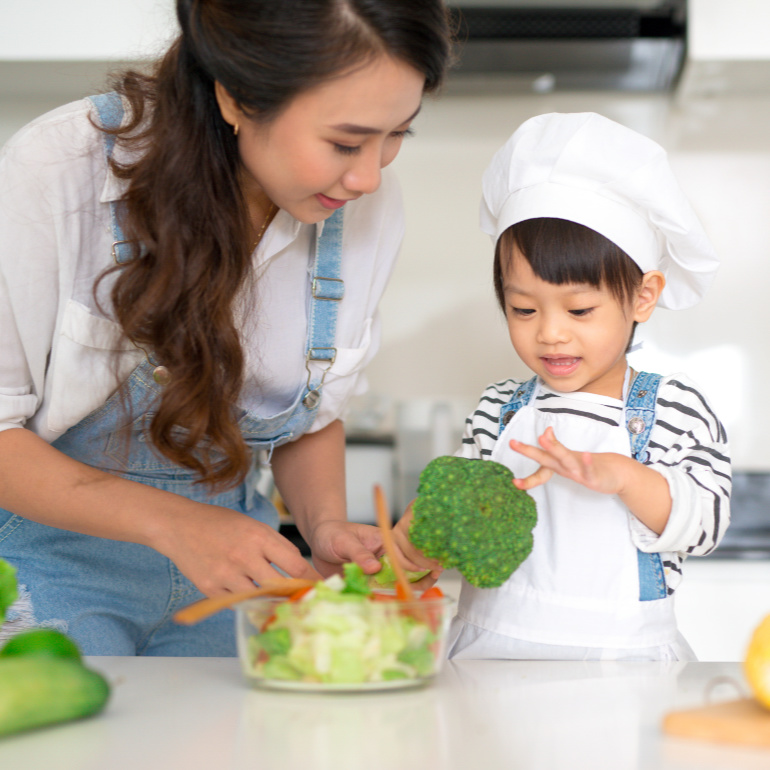 Mother and Child Cook Vegetarian Meal