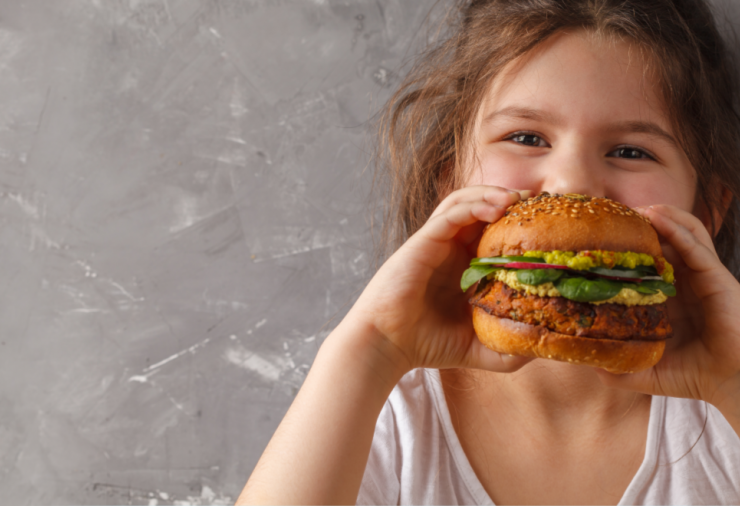 Girl Eating Veggie Burger